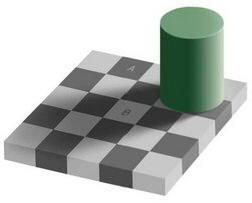An optical illusion. Square A is exactly the same shade of grey as square B
